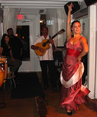 Flamenco dancer Sara Jerez performing Sevillanas accompanied by guitarist Miguelito