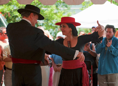 Some go all out in traditional Feria de Sevilla attire like Miles Hamby seen here dancing Sevillanas with a friend