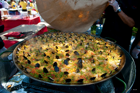 This is just one of many oversized pans of the most popular dish served at the DC Feria: paella