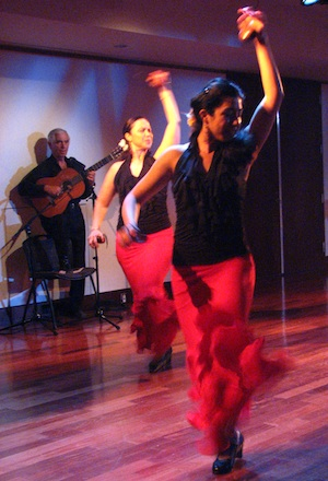 Flamenco guitarist Torcuato Zamora with dancers Sylvia and Karina in fandangos de Huelva