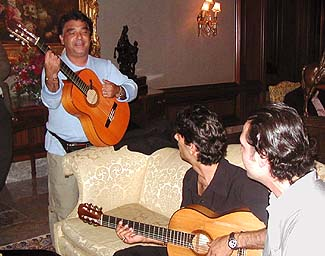 Nicolas sings and plays while Canut Amador and local singer-guitarist Kivanc look on