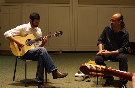 Guitarist Clarke Hedgepath performing for Miguelito at the masterclass at the James W. Black Music Center Recital Hall